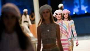 Models present creations by Chanel during a fashion show in Bangkok