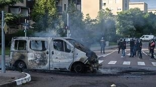 A burned-out van in the Gresilles neighbourhood of Dijon, eastern France, on Monday after a night of clashes.