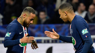 PSG stars Neymar and Mbappé celebrate after scoring at the Groupama Stadium in Lyon.