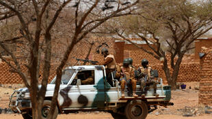 In this March 3, 2019 photo, soldiers are in the village of Gorgadji in the Sahel region of northern Burkina Faso.