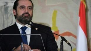 سعد الحريري في مؤتمر صحافي خلال اجتماع دعم لبنان في روما 15 آذار/مارس 2018.