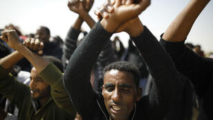 Menahem Kahana, AFP | African migrants protest outside an Israeli detention facility for African asylum seekers near Kziot in Israel's southern Negev desert near the Egyptian border on February 22, 2018.