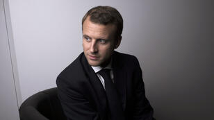 Emmanuel Macron poses at the Economy Ministry shortly after his appointment in August 2014