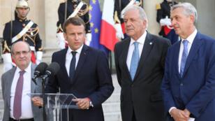 الرئيس الفرنسي إيمانويل ماكرون أثناء مؤتمر صحفي في قصر الإليزيه، باريس، 22 يوليو/تموز 2019
