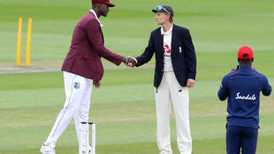 Return visit: West Indies captain Jason Holder (L) would like to see the England team of Joe Root in the Caribbean later this year