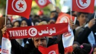 تظاهرة في الذكرى الخامسة لثورة 2011 التي أطاحت ببن علي، في 14 كانون الثاني/يناير 2016 على جادة الحبيب بورقيبة