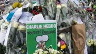 A makeshift tribute outside the Paris offices of the Charlie Hebdo satirical magazine, where 12 people were killed in 2015 in an attack that marked the start of a wave of jihadist attacks in France