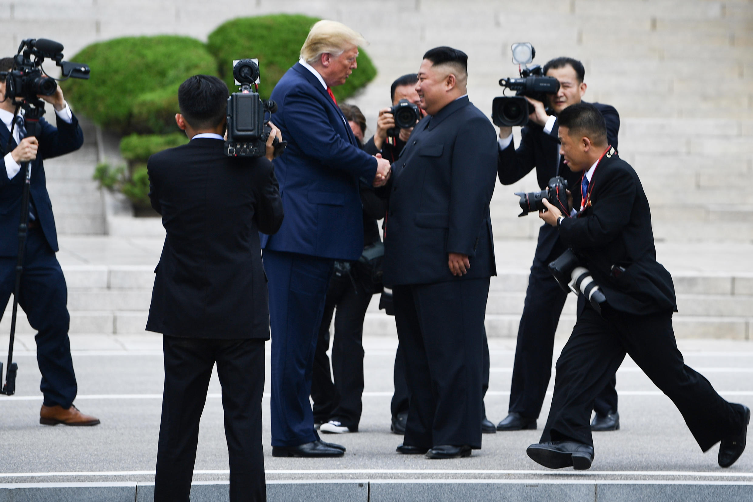 North Korean leader Kim Jong Un shakes hands with US President Donald Trump in the Demilitarized Zone of the two Koreas on June 30, 2019.