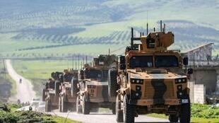 Turkish military vehicles on patrol in a de-militarized zone in the northwestern Syrian province of Hama province