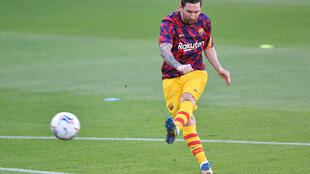 Lionel Messi warms up before Barcelona's friendly against Gimnastic Tarragona from the Spanish third tier