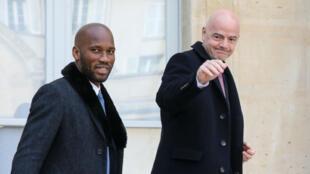 Didier Drogba, en compagnie du président de la Fifa Gianni Infantino.