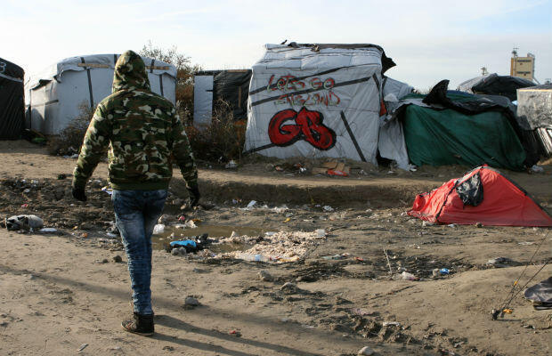 """The """"Jungle"""" camp is on the outskirts of town. Most of the 6,000 migrants there want to make it to Britain. Photo © Sarah Leduc"""