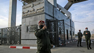 Members of the Palestinian security forces loyal to Hamas stand guard at the Rafah border crossing with Egypt