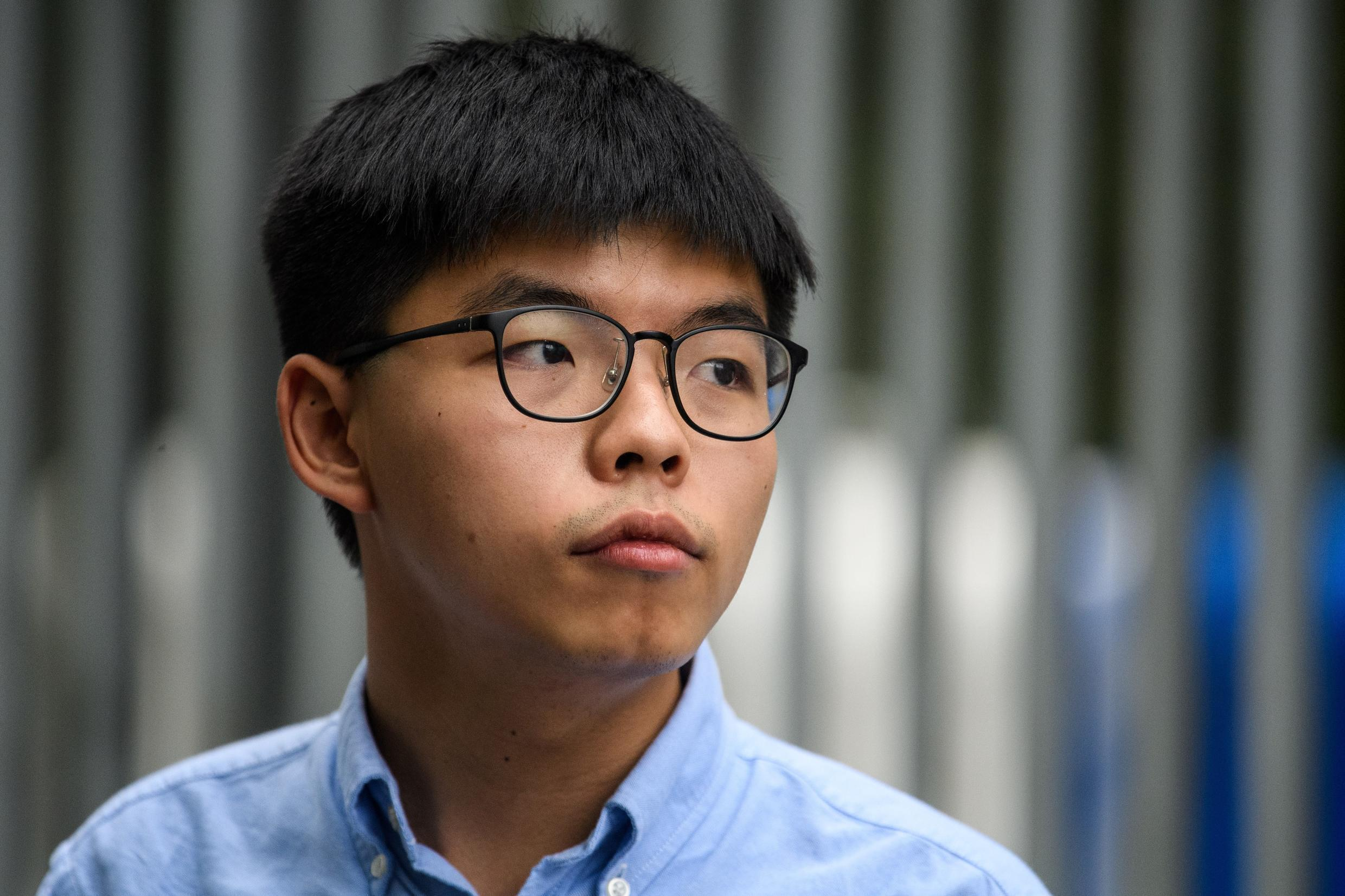 """Jailed Hong Kong dissident Joshua Wong pleaded guilty taking part in an """"unlawful"""" Tiananmen Square protest last year"""