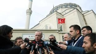 Turkish President Tayyip Erdogan talks to journalists in front of a mosque as he leaves friday prayers in Istanbul, Turkey, February 21, 2020 OK