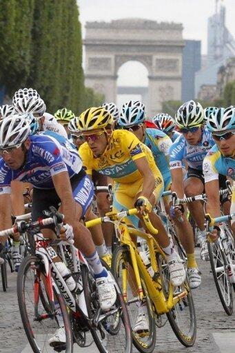 Triumphant Contador racing on the Champs Elysees