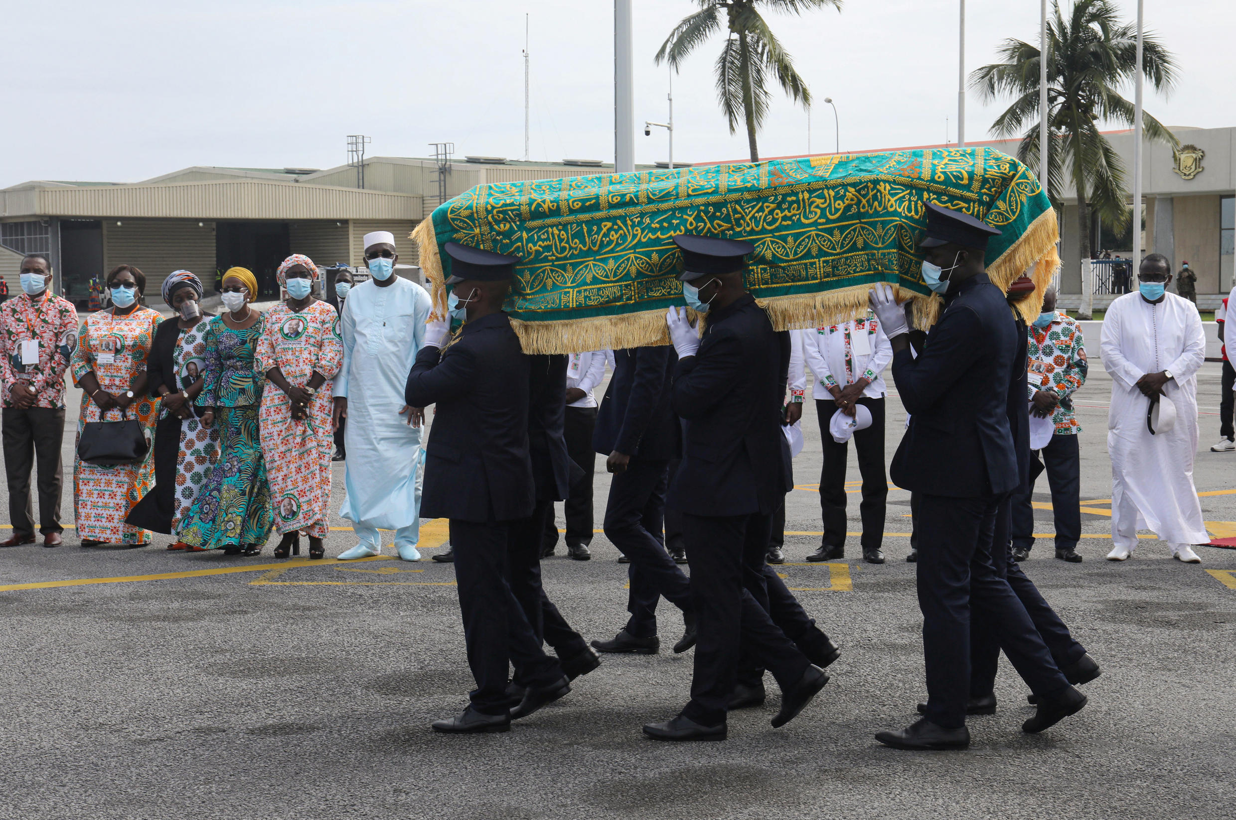 The remains of Ivorian Prime Minister Amadou Gon Coulibaly are transported to Felix Houphouet Boigny airport for transfer to his native village of Korhogo on July 15, 2020.