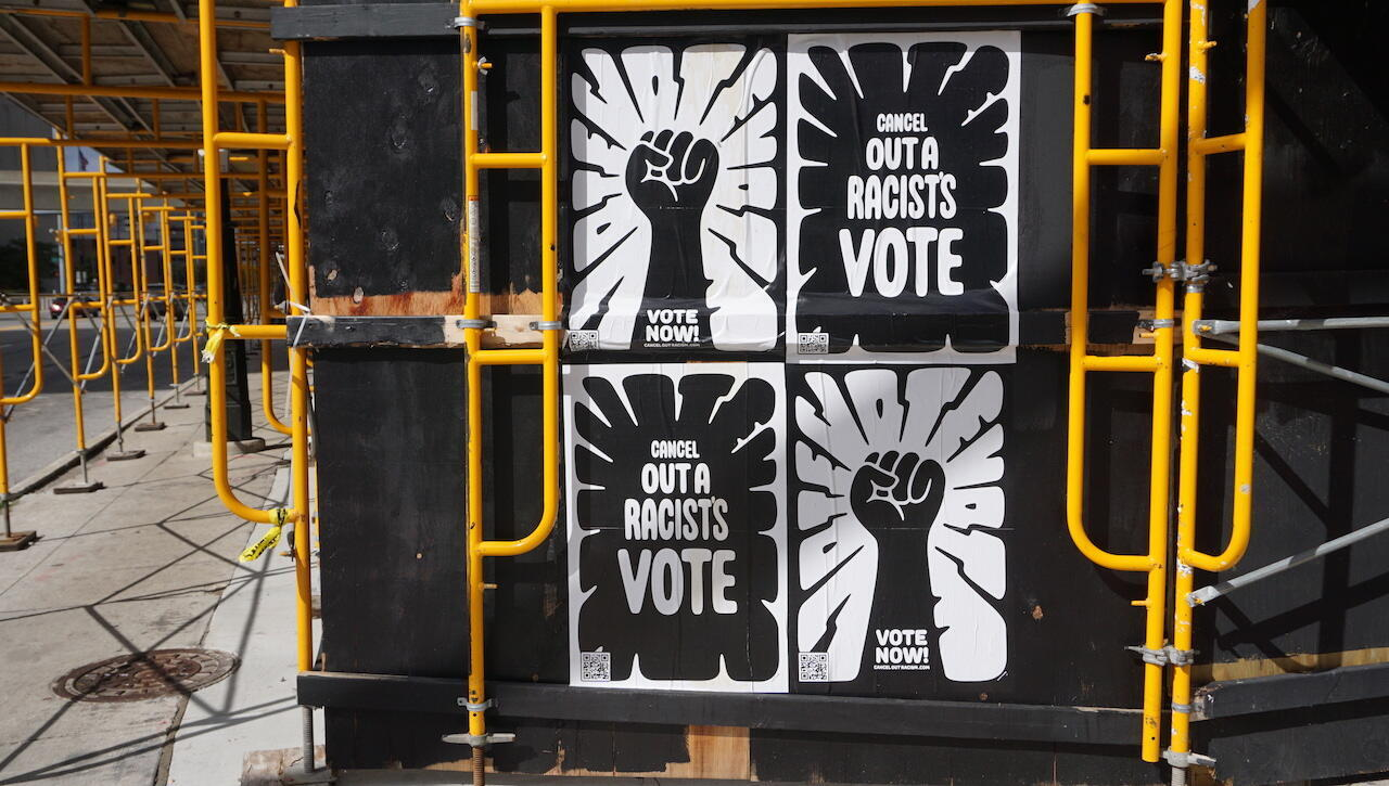 'Cancel out a racist's vote': Posters in downtown Detroit.