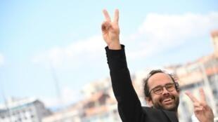 """Le paysan militant Cédric Herrou au Festival de Cannes, le 18 mai 2018, pour la présentation du film """"À tous vents""""."""