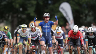 Stage winner Mark Cavendish of Great Britain celebrates as he crosses the finish line of the 4th stage of the 108th edition of the Tour de France, June 29, 2021.