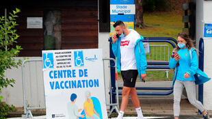 Residents leave a vaccination centre in Capbreton, in the Landes region, southwestern France, June 24, 2021.