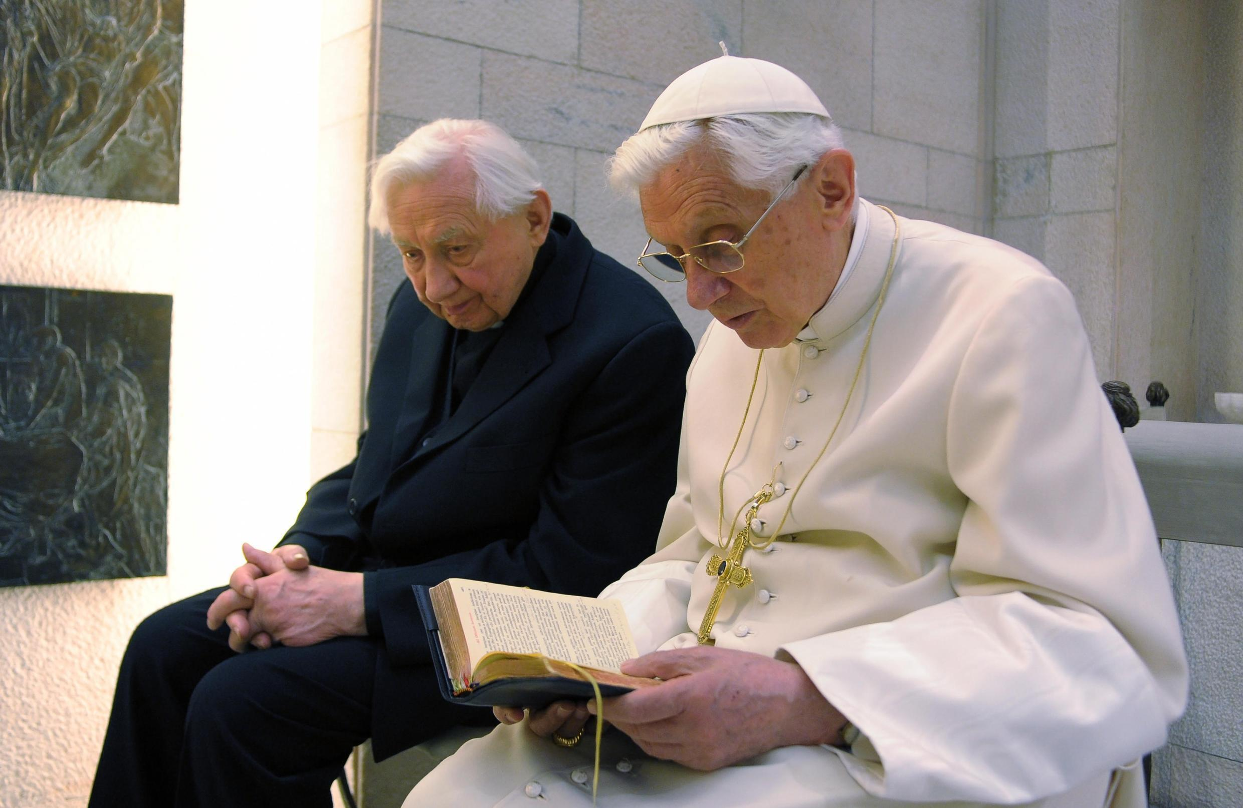 Former pope Benedict XVI, right, pictured with his brother Georg Ratzinger at the Vatican in 2012