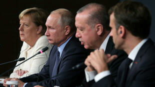 The leaders of Germany, Russia, Turkey and France  attend a news conference after talks on the Syrian conflict in Istanbul, Turkey, in October 2018.