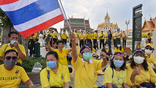 Royalist supporters gather near pro-democracy protesters in Bangkok on October 14, 2020.