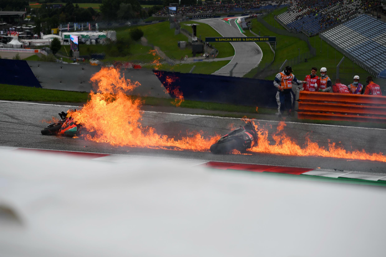 Lorenzo Savadori's Aprilia and Dani Pedrosa's KTM caught fire after crash that interrupted the Styrian Grand Prix