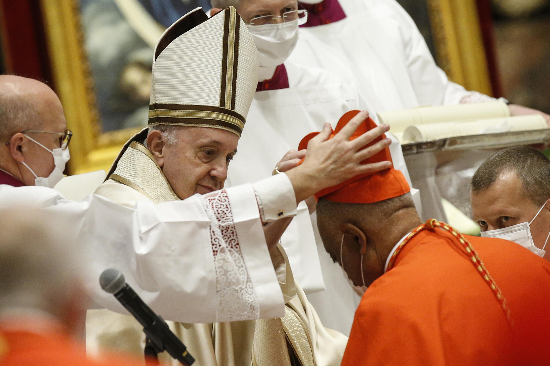 US Archbishop Wilton Gregory of Washington receives his biretta from Pope Francis