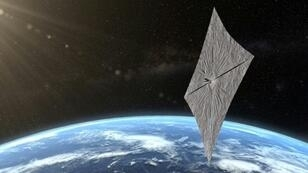 An artist's concept of LightSail 2 is depicted above Earth in this image released by the Planetary Society