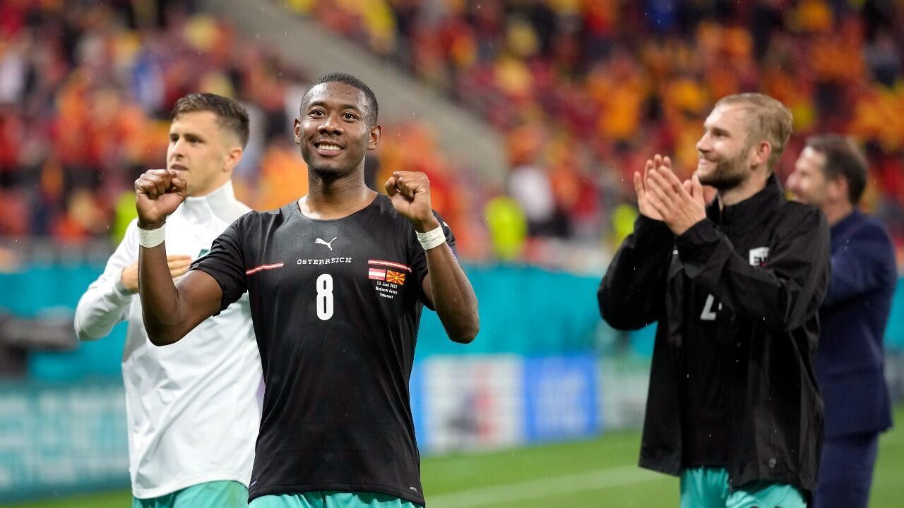 David Alaba celebrates Austria's victory alongside his teammates.