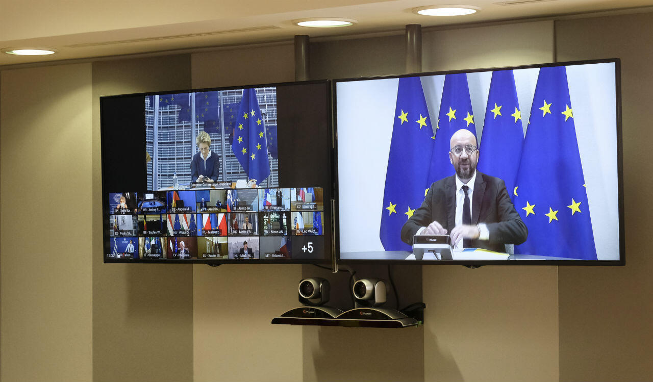 European Commission President Ursula von der Leyen (L) and European Council President Charles Michel are seen on-screen as they attend an EU video conference in Brussels on June 19, 2020.