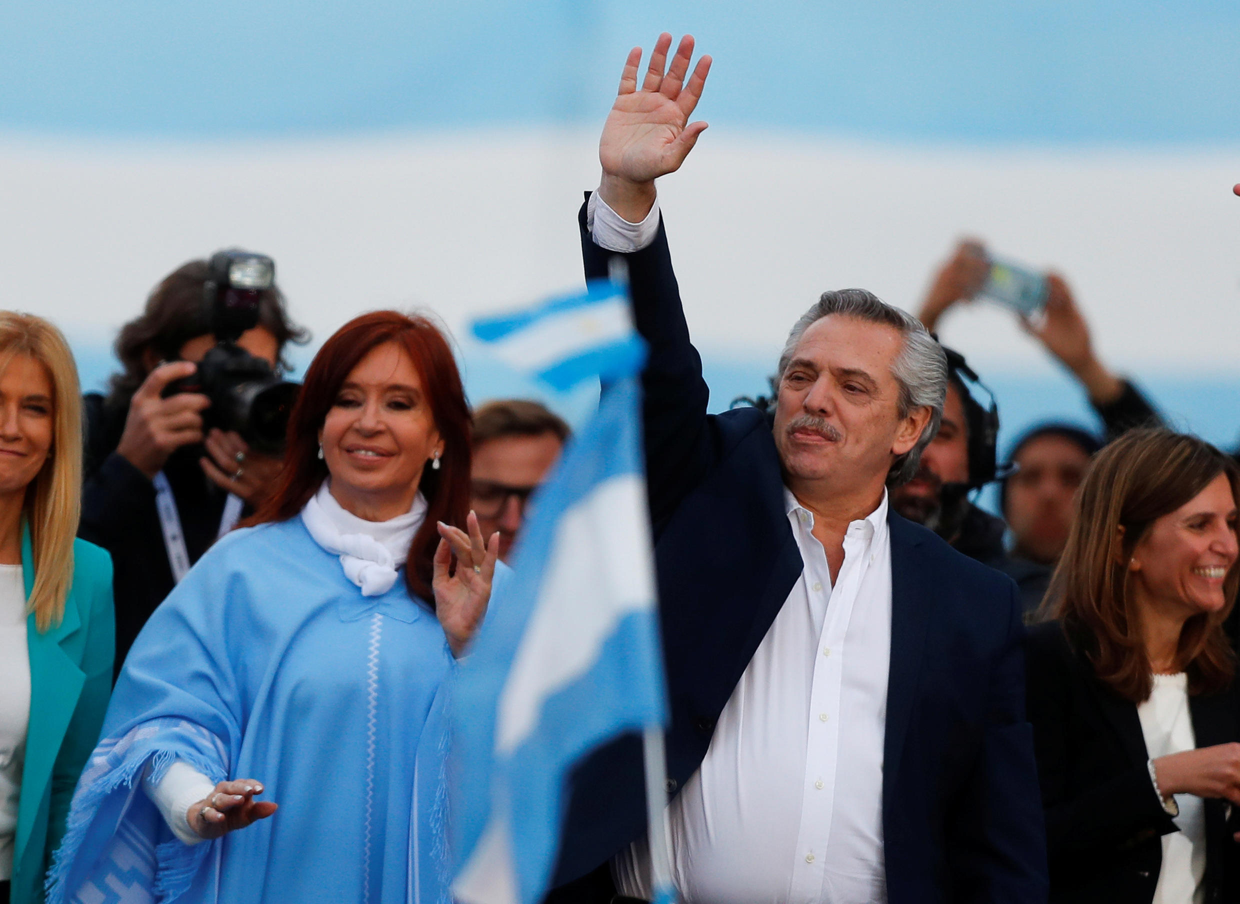 Argentina's presidential candidate Alberto Fernandez and his running mate former President Cristina Fernandez greet supporters during a closing campaign rally in Mar del Plata, Argentina, on October 24, 2019