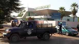 Police in front of the formerly quarantined Pasteur clinic in Bamako on November 12.