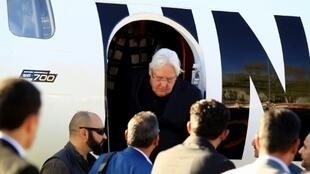 Martin Griffiths (C), the UN special envoy for Yemen, descends from his plane upon his arrival at Sanaa international airport on January 5, 2019
