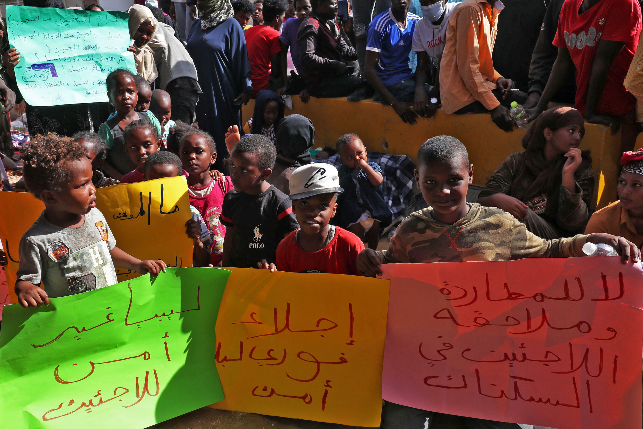 African migrants demonstrate outside the Tripoli office of the UN refugee agency demanding repatriation after Friday's shooting deaths again highlighted the appalling conditions they endure in Libya