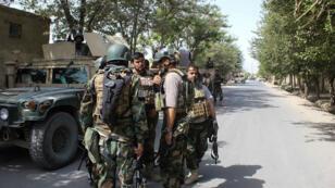 Des soldats afghans dans une rue de Kunduz, le 31 août 2019.