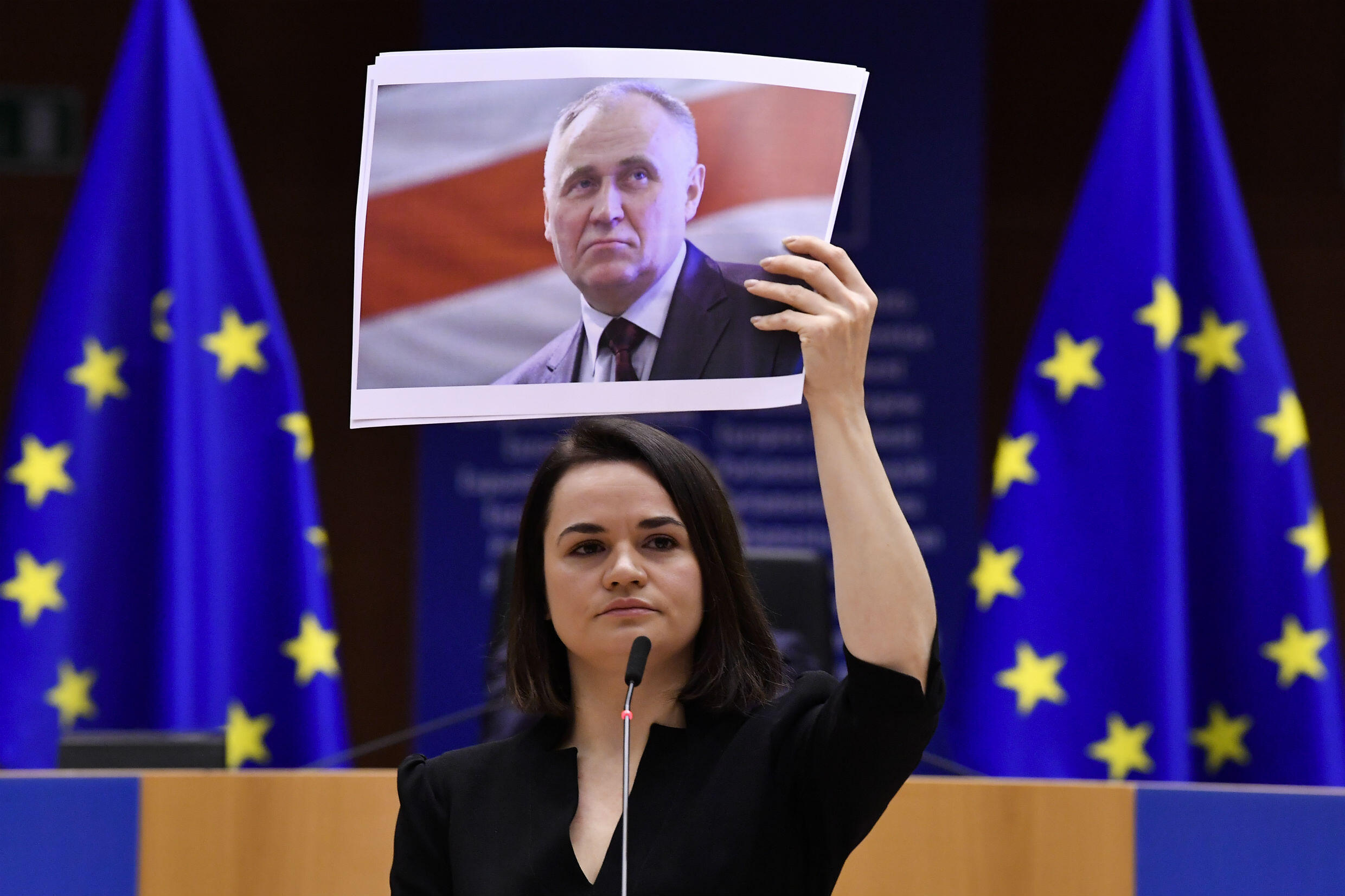 Belarus opposition leader Svetlana Tikhanovskaya holds a picture of Belarusian politician Mikalai Statkevich while receiving the Sakharov human rights prize at the European Parliament on December 16, 2020.