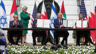 Bahrain's Foreign Minister Abdullatif Al Zayani applauds as Israel's Prime Minister Benjamin Netanyahu, US President Donald Trump and United Arab Emirates Foreign Minister Abdullah bin Zayed display their copies of signed agreements as they participate in the signing ceremony of the Abraham Accords at the White House in Washington, D.C., USA, September 15, 2020.