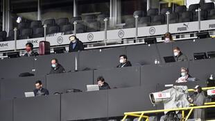 Plenty of room for a view: Journalists in the press tribune at Saturday's game between Borussia Dortmund and Schalke which was played in the absence of spectators