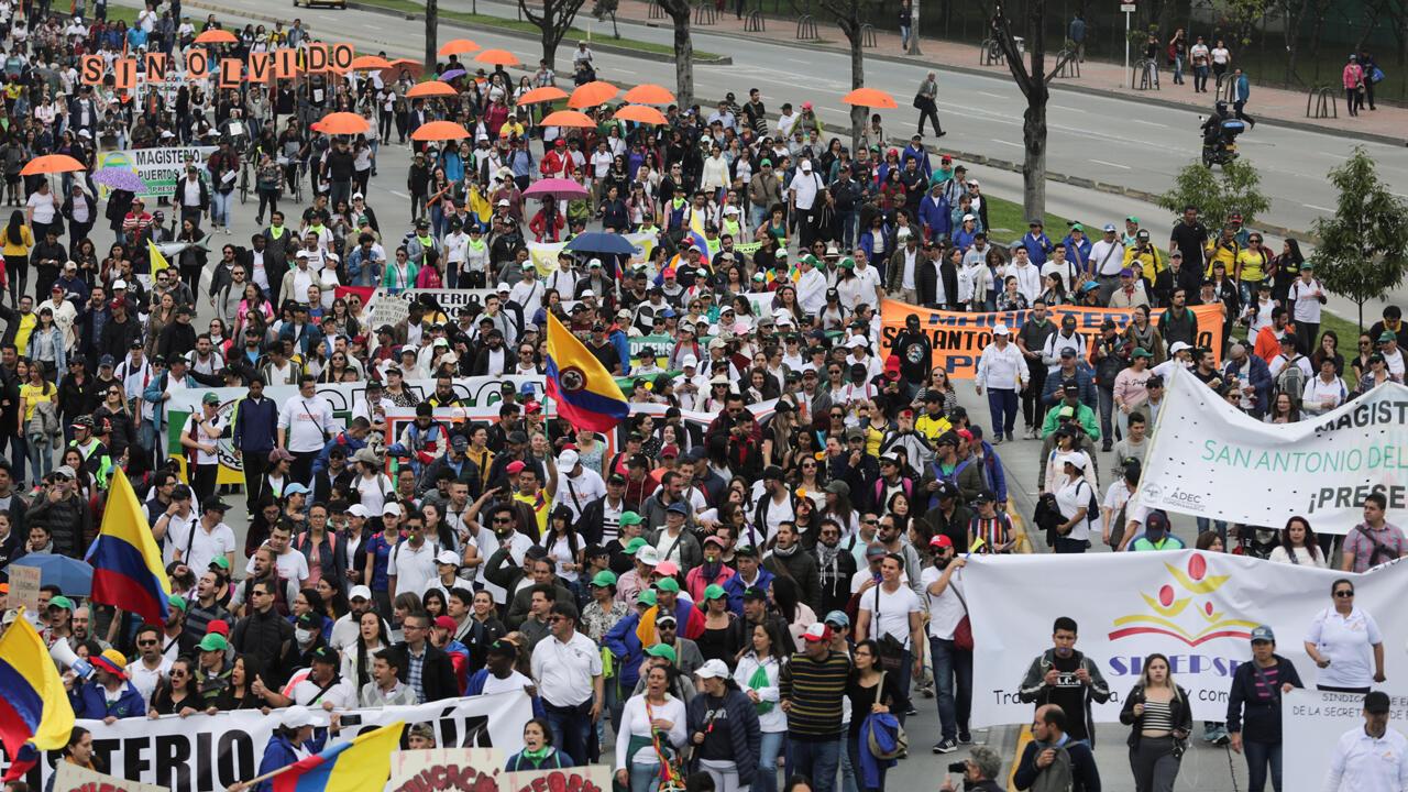 Demonstrators march in Bogota, Colombia, on November 21, 2019.