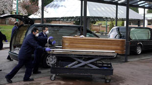 Employees of a mortuary enter the crematorium of La Almudena cemetery with a coffin of a person who died of coronavirus disease (COVID-19) during partial lockdown to combat the coronavirus disease (COVID-19) outbreak in Madrid, Spain, March 23, 2020.