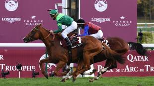Jockey Cristian Demuro celebrated as Sottsass won the Prix de l'Arc de Triomphe