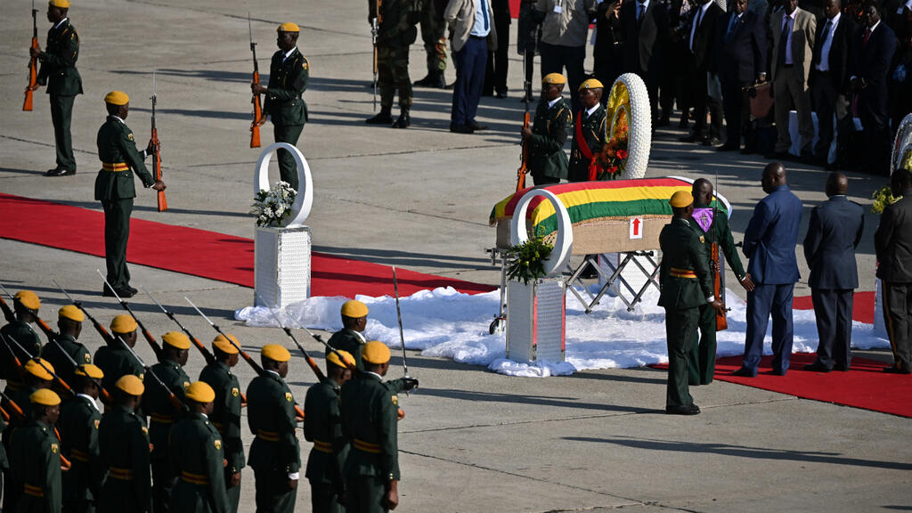 Zimbabweans divided as Mugabe's body arrives home for burial