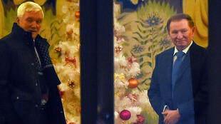 Former Ukrainian president Leonid Kuchma (right) and Russia's ambassador to Belarus Alexander Surikov on Christmas Eve in Minsk.