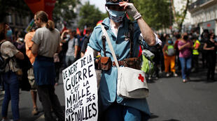 "A health worker calling for ""maille"" (money), not medals, at a protest in Paris on July 14, 2020."