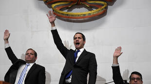 Venezuelan opposition leader and self-proclaimed acting president Juan Guaido (C) speaks after swearing in as parliament speaker, at the National Assembly, in Caracas, on January 7, 2020.
