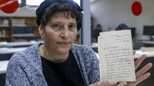 Archivist at the National Library of Israel Rachel Misrati displays a letter dated 1900 by Oxford English Dictionary editor James Murray