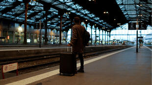 A traveller waits in an empty Gare de Lyon as the transport strike against pension reform hits its 18th day on Sunday December 22 2019.